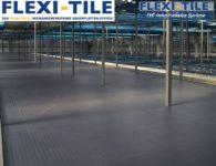 Flexi-Tile PVC Boden Industriebodenbelag in Lagerhalle - Genoppte Ausfu¦êhrung
