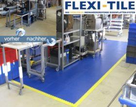 Flexi-Tile PVC Fliesen Arbeitsplatzboden Beispielanwendung in Dunkelblau mit gelben Rampen und Ecken